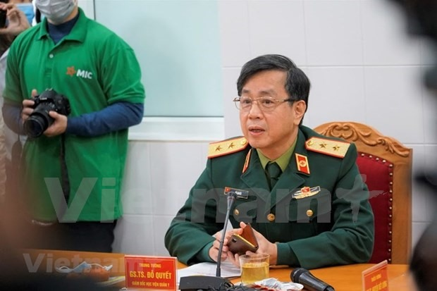 Prof. Dr. Do Quyet, Director of the Military Medical Academy, speaks to the press following the trial vaccination. (Photo: VNA)