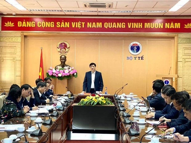 Minister of Health Nguyen Thanh Long (standing) at the meeting with Vietnamese vaccine producers on December 5 (Photo: VNA).