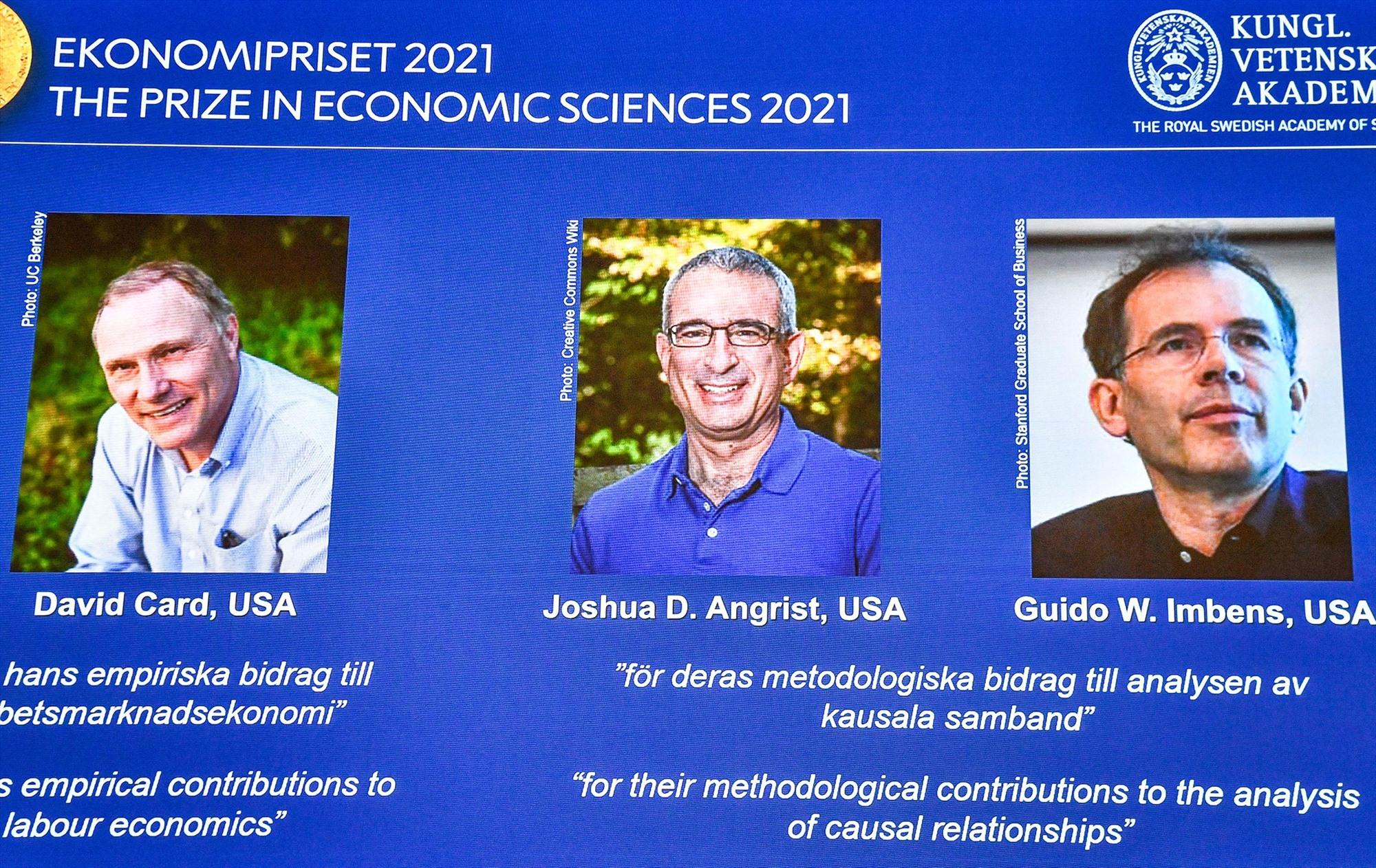 Những chủ nhân giải Nobel KInh tế 2021. Ảnh: AFP