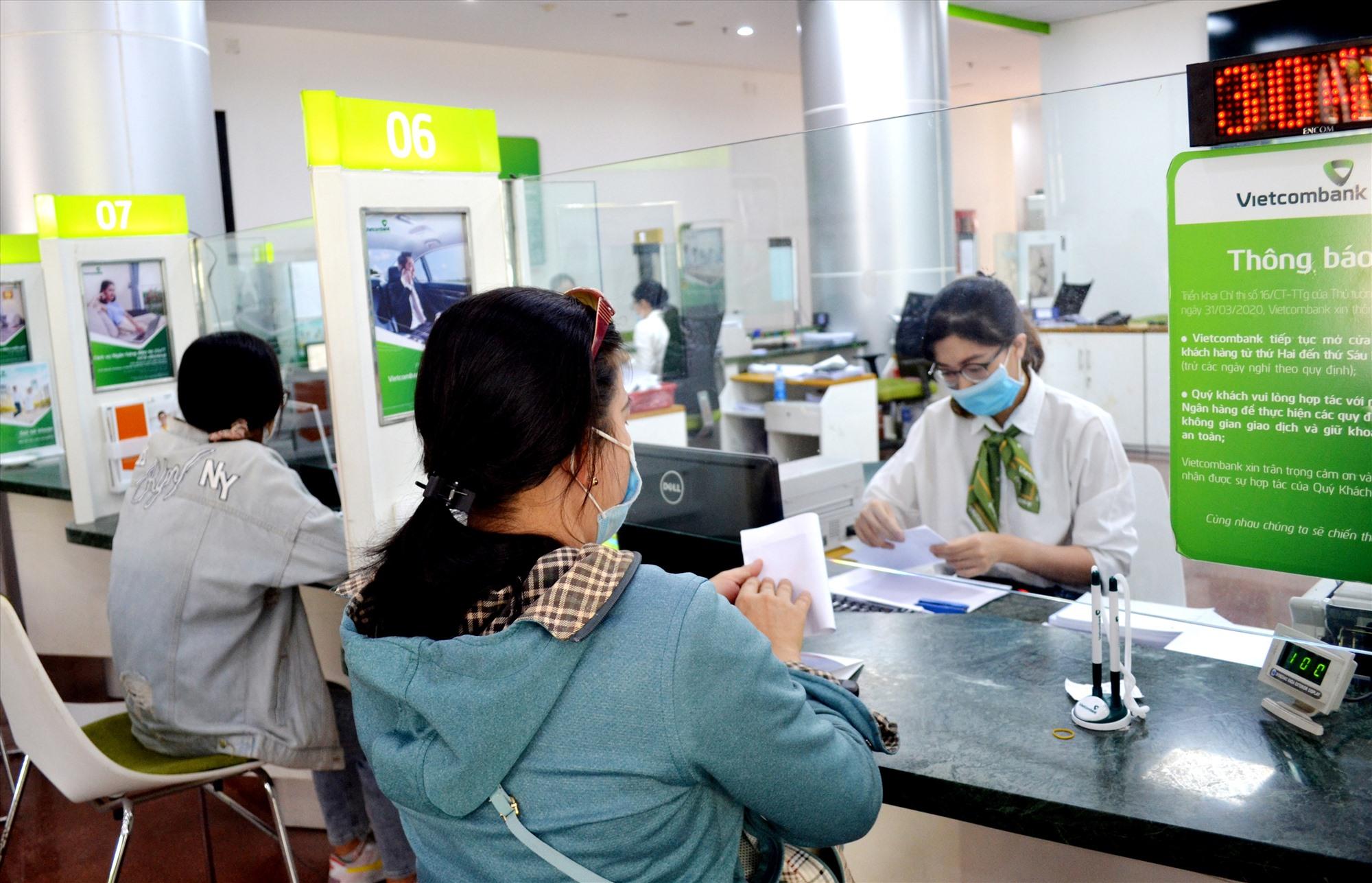 Vietcombank chi nhánh Quảng Nam hỗ trợ doanh nghiệp, người dân vay vốn với lãi suất khá thấp. Ảnh: VIỆT NGUYỄN