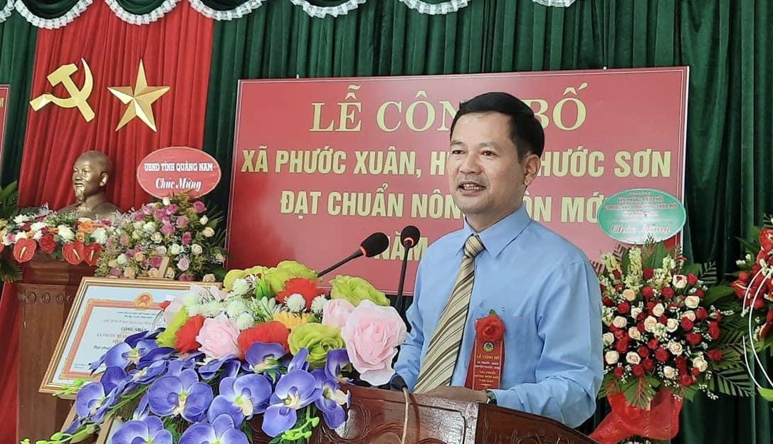 Ông Lê Quang Trung phát biểu tại lễ công bố xã đạt chuẩn NTM.