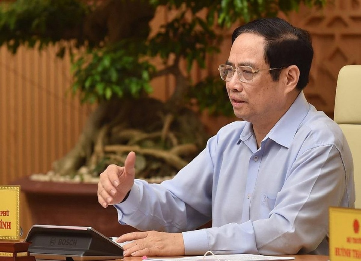 PM Pham Minh Chinh says a greater effort should be made to speed up vaccine research and development so that the first locally produced COVID-19 vaccine is likely to be marketed in September. (Photo:VGP)