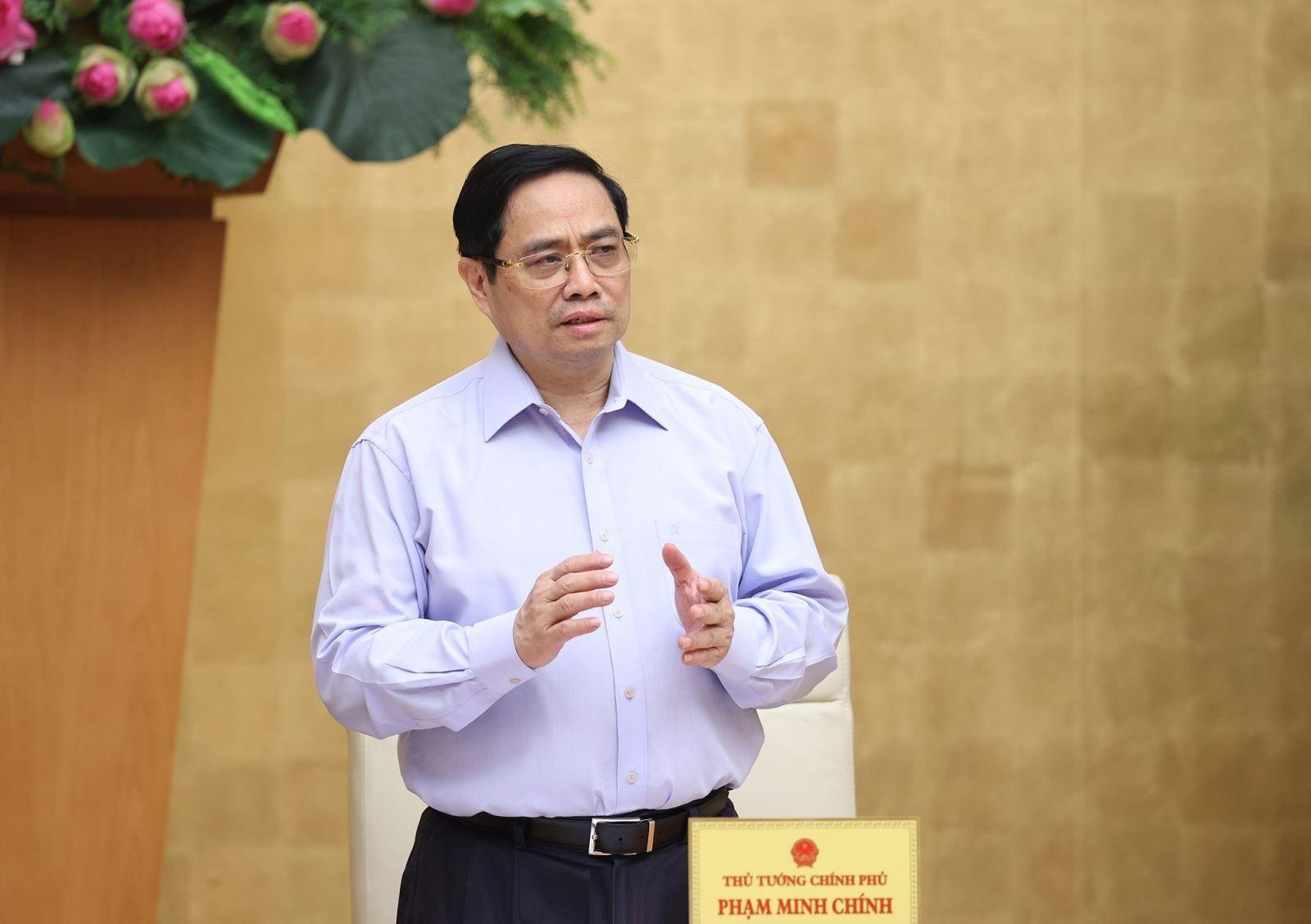 Thủ tướng Phạm Minh Chính chỉ đạo tập trung lãnh đạo, chỉ đạo và đẩy mạnh huy động sự tham gia của nhân dân trong phòng chống dịch COVID-19. Ảnh: TTXVN