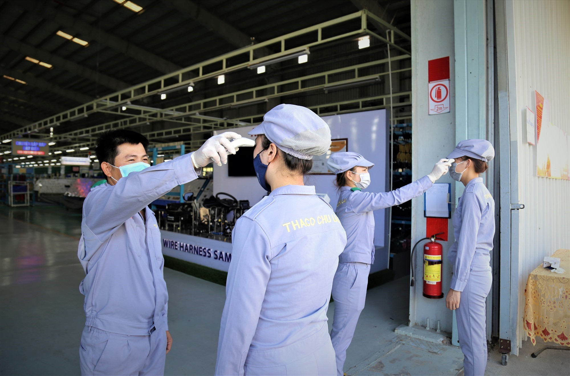 Measuring body temperature for employees before entering the factory
