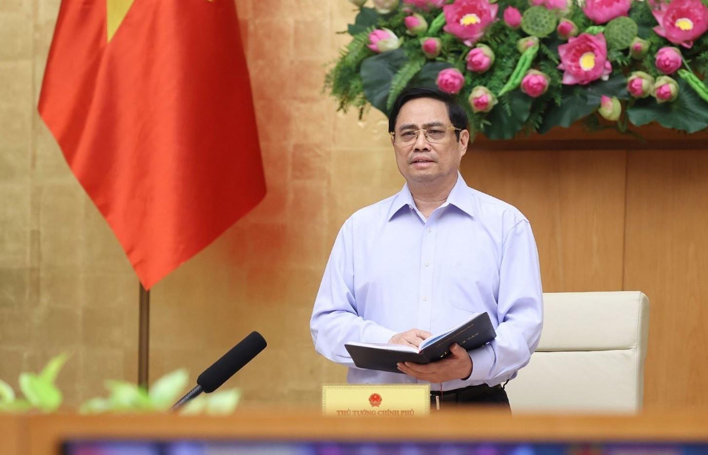 Thủ tướng Chính phủ Phạm Minh Chính yêu các Bộ ngành, địa phương tăng cường thực hiện các biện pháp phòng, chống dịch COVID-19. Ảnh: TXVN
