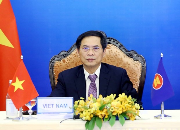 Vietnamese Foreign Minister Bui Thanh Son on August 6 took part in the virtual ASEAN-EU Foreign Ministers' Meeting. (Photo: VNA)