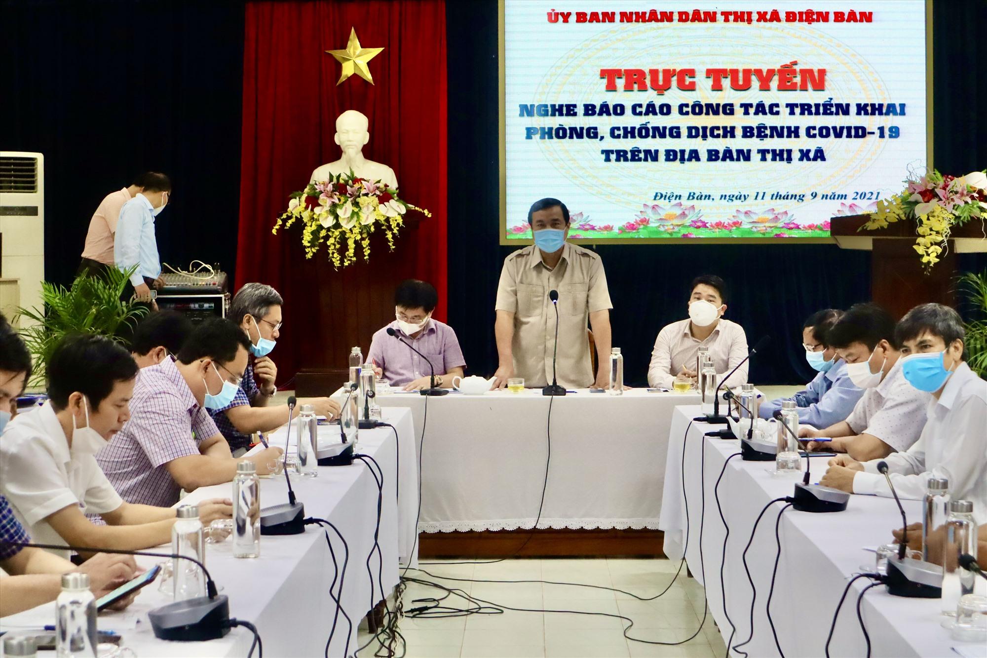Bí thư Tỉnh ủy Phan Việt Cường chủ trì buổi làm việc với Điện Bàn về công tác phòng, chống dịch Covid-19 cuối tuần qua. Ảnh: Q.T