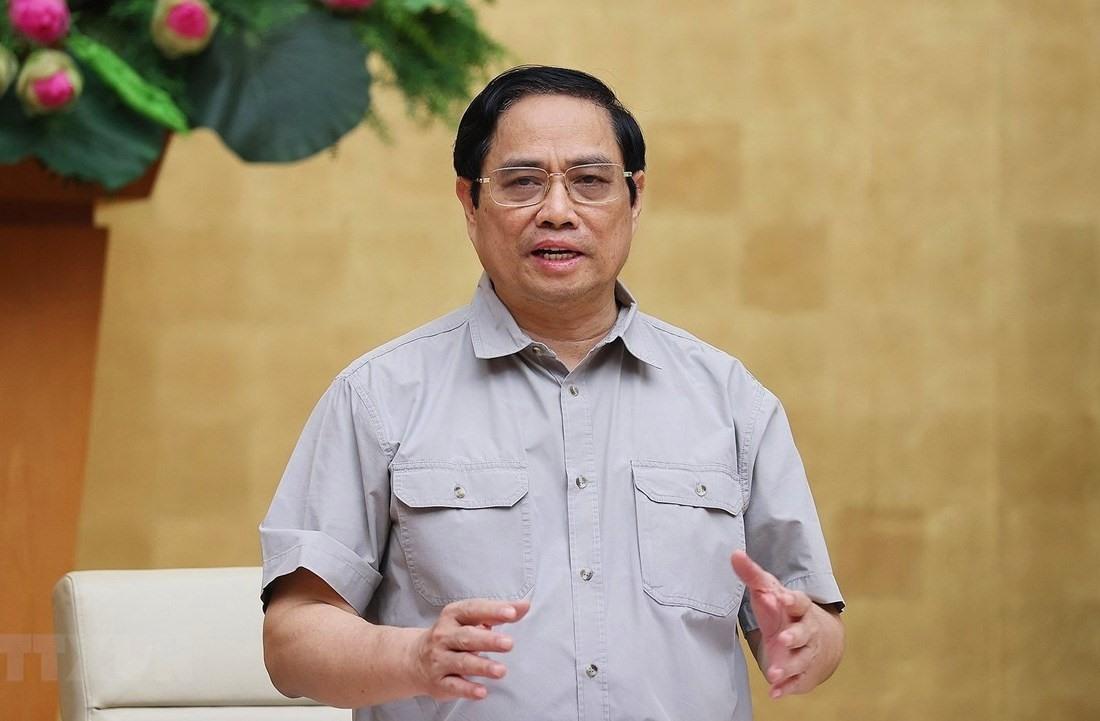 Thủ tướng Phạm Minh Chính, Trưởng Ban Chỉ đạo Quốc gia phòng, chống dịch COVID-19 chủ trì cuộc họp. Ảnh: Dương Giang/TTXVN.